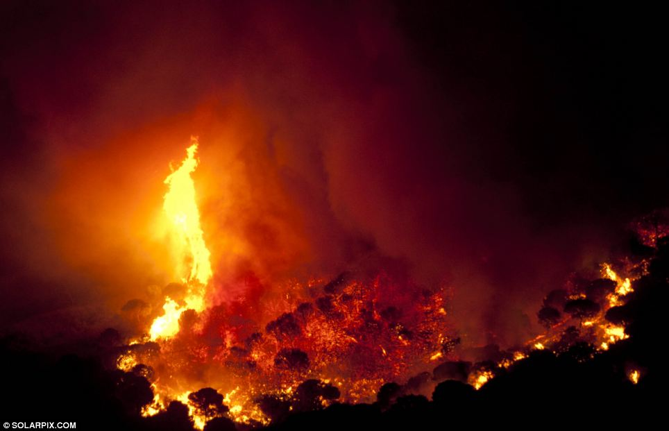 Red hot: The night sky was turned red as the intense fire continued to burn
