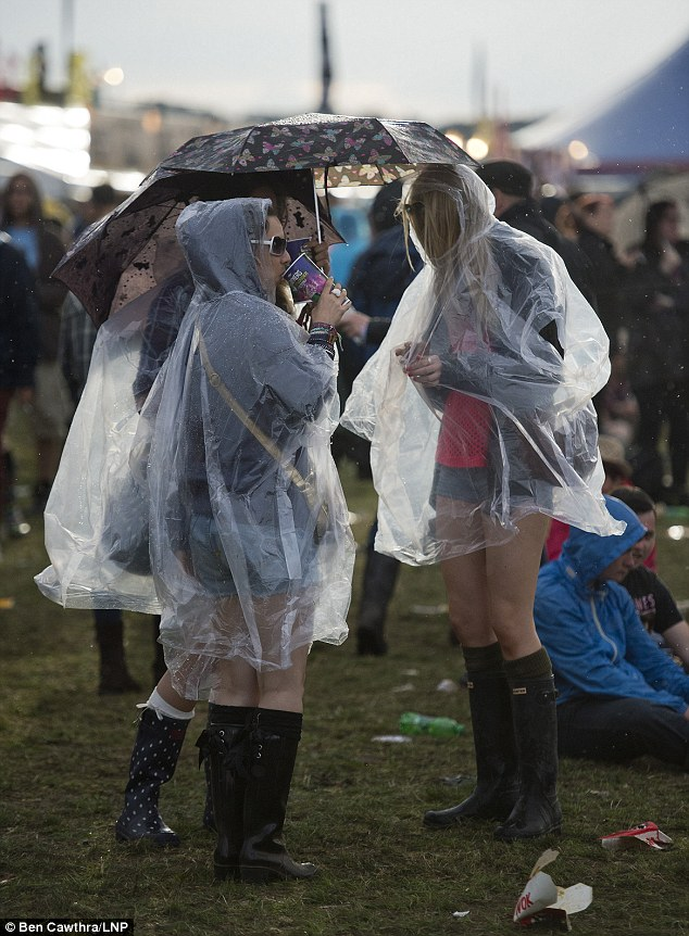 Soaked: Last weekend 80,000 rain soaked revellers enjoyed the Reading Festival despite the weather