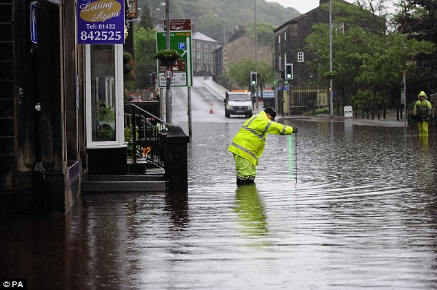 Chaos: Floodwaters surrounded the houses and local shops in the centre of Hebden Bridge, West Yorkshire, in June after torrential downpours brought flooding to swathes of northern England