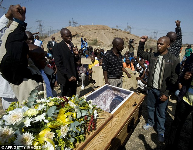 the coffin of Mpuzeni Ngxande, one of the 34 striking miners killed by police