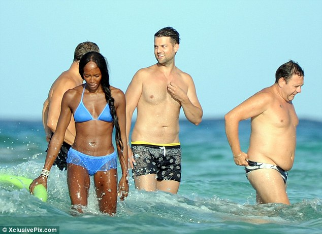 Fun in the sun: Naomi was cavorting in the sea with a group of pals and boyfriend Vladislav Doronin