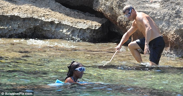 Water baby: Naomi donned a fetching pair of goggles as she took to the sea with boyfriend Vladislav Doronin