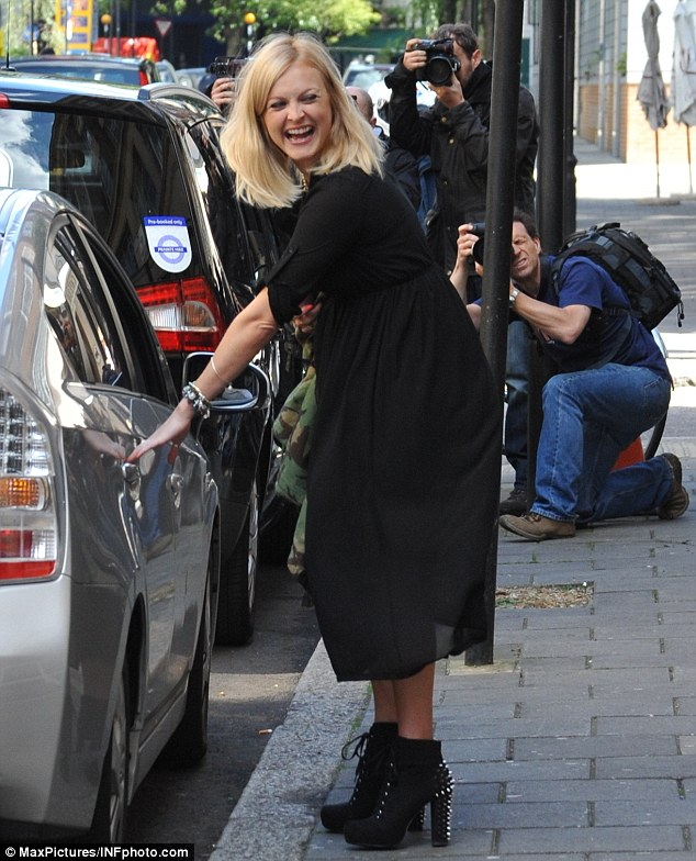 Radiant: Pregnant Fearne Cotton couldn't keep the smile off her face as she left the Radio 1 studios in central London earlier today