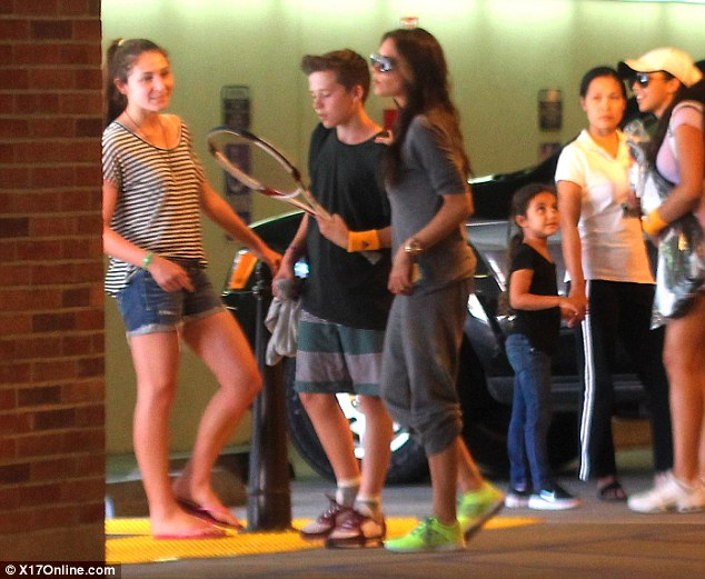 Fitting in: She seemed happy and relaxed as she patted Brooklyn on his shoulder and chatted amongst her teenage friends
