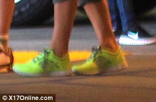 What, no heels?! Victoria never normally walks along in flats let alone trainers