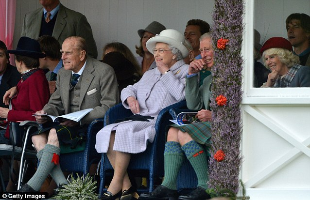 Fun day out: Prince Philip, Duke of Edinburgh, Queen Elizabeth II and Prince Charles, Prince of Wales pictured at the Braemar Highland Games