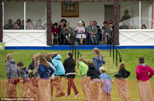 Fun and games: The Royal family watch the proceedings intently