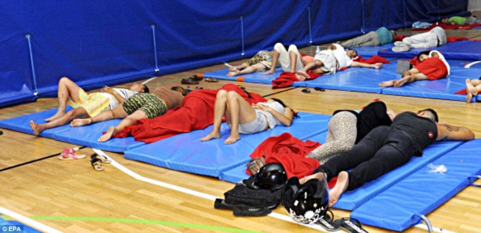 Evacuated: Many were forced to take rest in the local sports center after being evacuated from their homes due to the fires