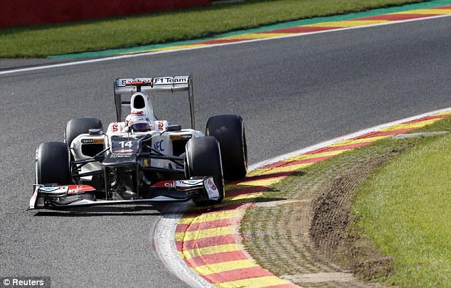 Right up there: Sauber's Kamui Kobayashi of Japan joins Button at the head of the pack