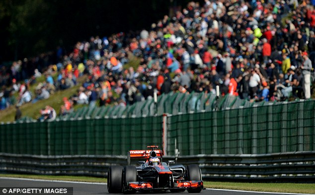 Front row: Jenson Button is on pole position for the Belgian Grand Prix