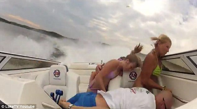 Lost control: The driver is slammed to the side of the boat after losing control