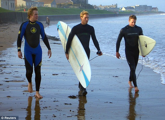 Sharing interests: Prince William, pictured centre in St Andrews, Scotland, in 2004, has always been a keen surfer