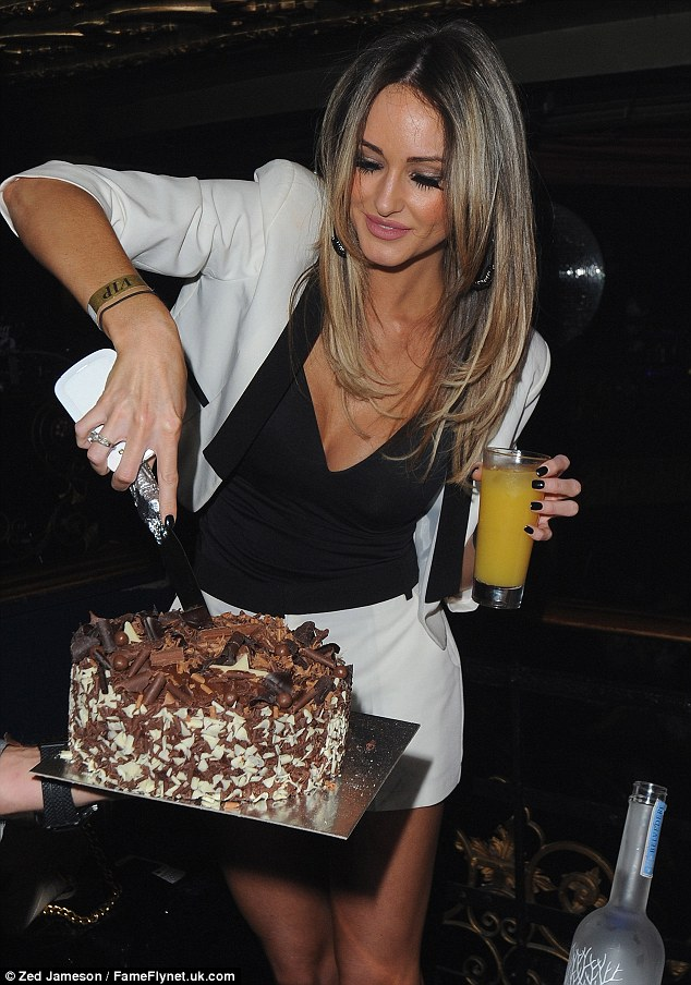 This is Lauren's piece! Georgina gets stuck in as she is presented with a rather yummy looking chocolate cake