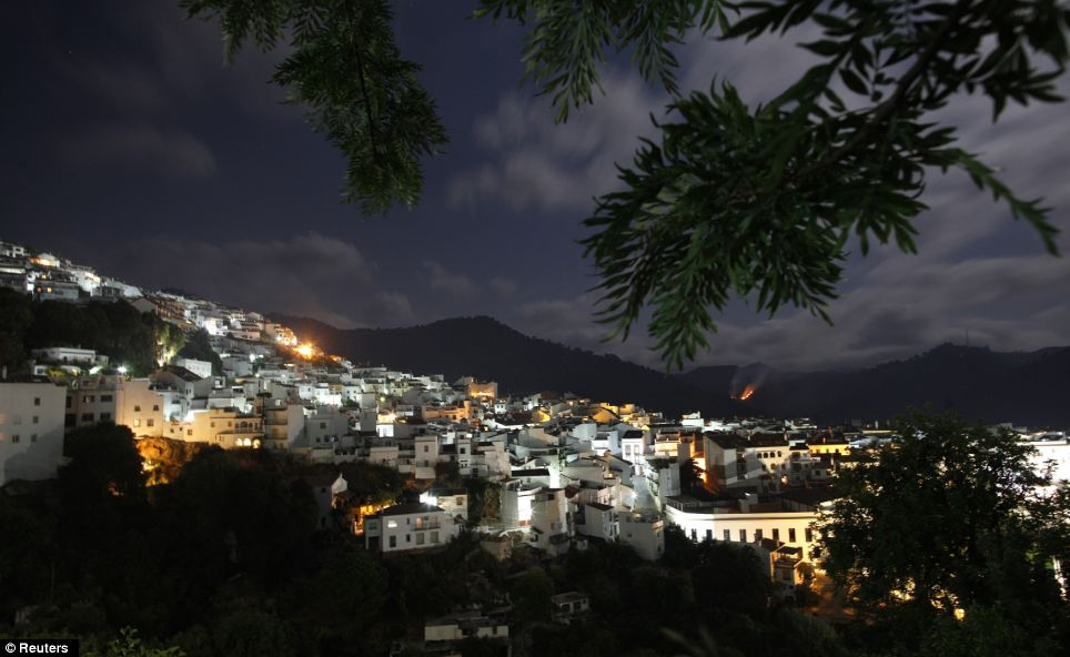 A small forest fire is seen on a mountain near the town of Ojen, near Malaga, southern Spain