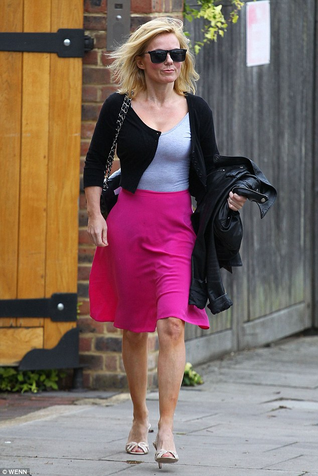 In the pink! But Geri's new boyfriend has left her confused with his 'exhausting intelligence'