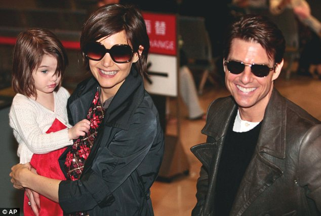 Family: The once-golden Hollywood couple together with their daughter Suri in Japan in 2009