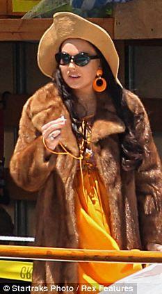 Day job: Lohan on the set of Liz & Dick in LA