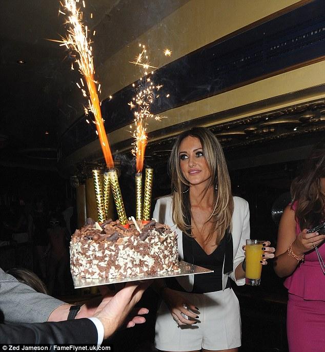 You sparkler! Georgina gets a glimpse of her cake