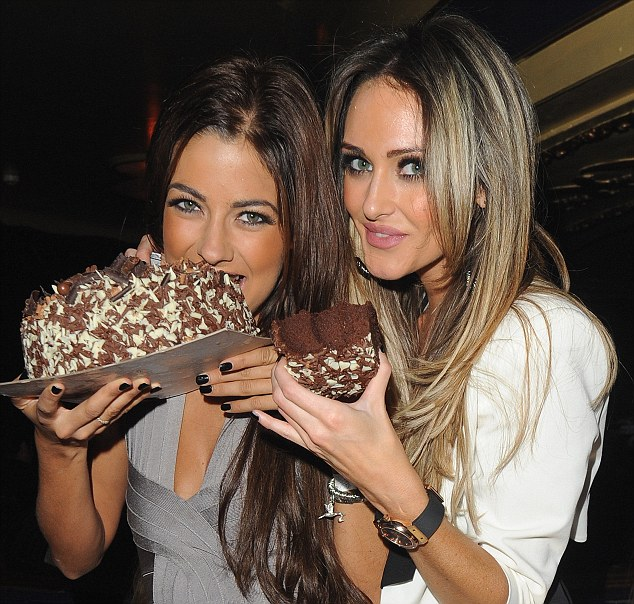 Getting in with gateau: Georgina and pal get stuck into the chocolate cake