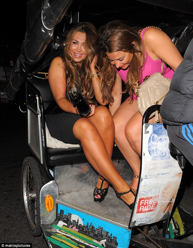 On the highway to drunkeness! Leggy Lauren hails a Tuk Tuk for the party but still manages to pose up