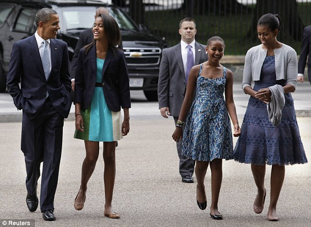 All smiles: U.S. President Barack Obama and first lady Michelle Obama like to stay home with their daughters Malia, pictured left, and Sasha, right, rather than go out