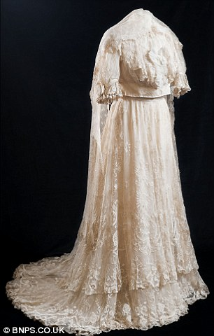 Stunning: Ethel Dalzeil, left, wearing the dress on her wedding day in 1908, may be the first and last bride to wear the garment down the aisle because it is so tiny even the most petite of women would struggle to fit into it