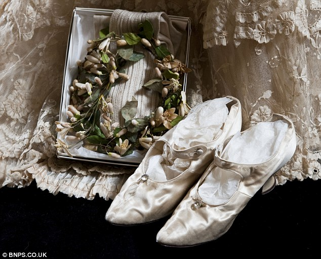 Delicate: Petite Ethel Dalziel wore the wedding dress and tiny size one slippers when she married Ronald Cooper in Glasgow in 1908