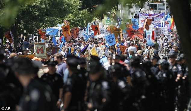 Angry: About 600 marchers carried signs and banners, banged drums and chanted on a sunny afternoon as part of the March on Wall Street South