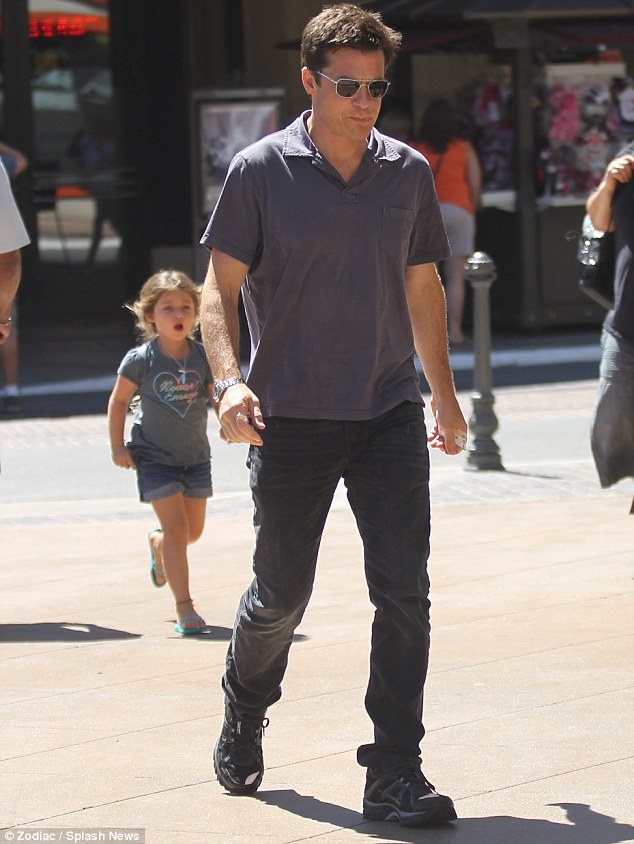 Daddy and me: Bateman walks across The Grove shopping centre with hsi eldest