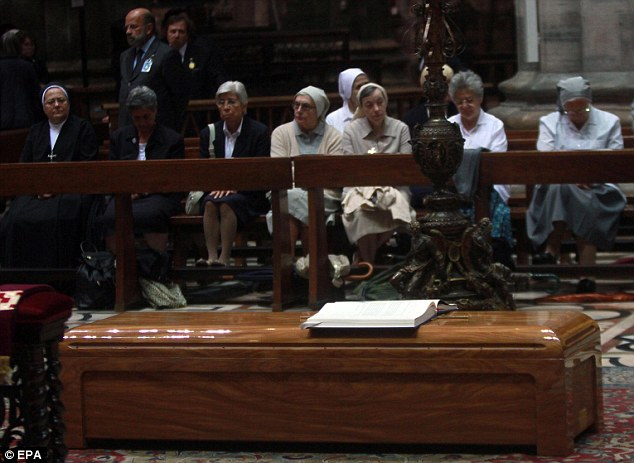Sombre: The casket containing Italian cardinal Carlo Maria Martini rests inside Milan's Duomo yesterday