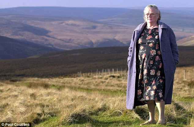 Grief: Keith Bennett's mother Winnie Johnson, pictured on Saddleworth Moor above Oldham, died last month having never been able to lay her son to rest