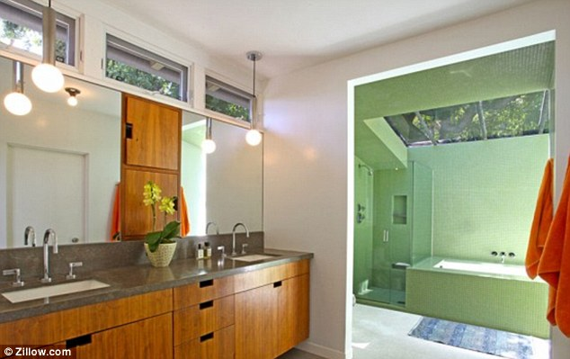 His and hers: The pair each had their own sink in the lavishly decorated home