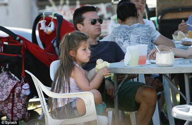 Time for snack: The adorable family stopped for food in the Farmer's Market