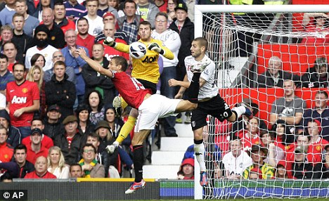 Woops: De Gea played a part in Fulham's second goal against United