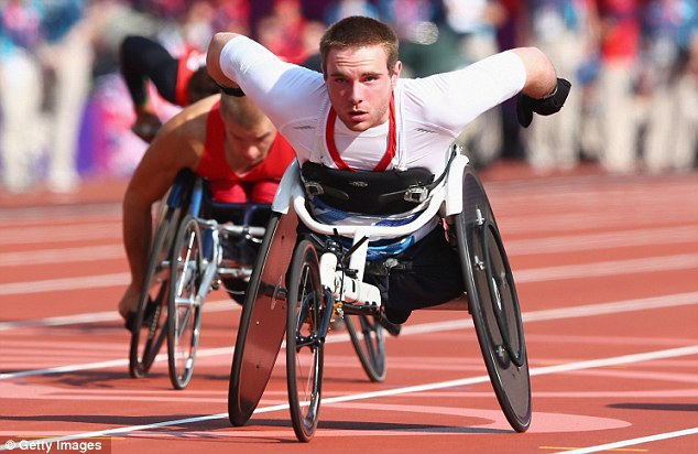Going for gold: Mickey Bushell races in the T53 100m final on Monday night
