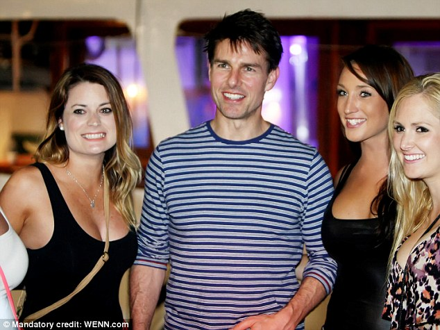 Newly single: Cruise poses with fans while out with friends in Croatia last night; the star's representative has issued a statement dismissing as 'lies' Vanity Fair's report that the Scientology Church recruited girlfriends for him