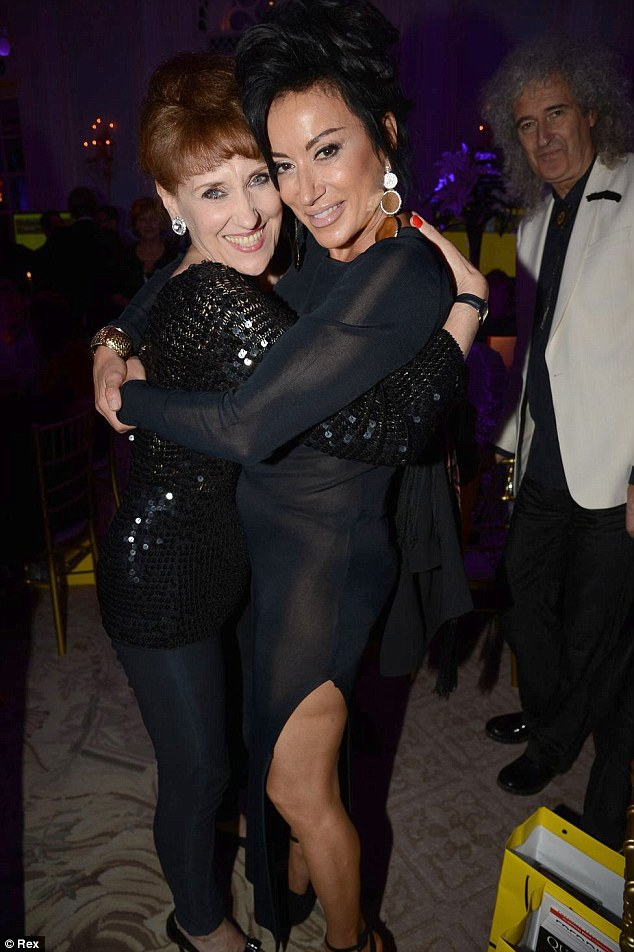 Cuddling up: Anita Dobson and Nancy Dell'Olio posed up for photographers inside the Savoy