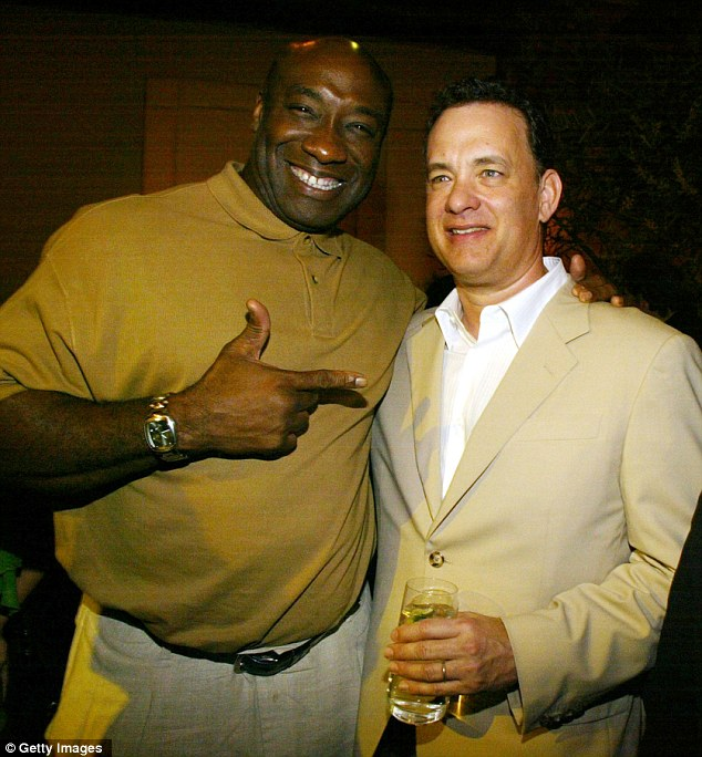 Buddies: Michael Clarke Duncan and Tom Hanks at the afterparty of the Ladykillers premiere at the El Capitan Theatre in Hollywood back in 2004