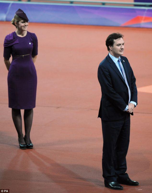 Awkward moment: Chancellor George Osborne prepares to present medals for the men's T38 400m race, during which he was loudly booed as his name was announced