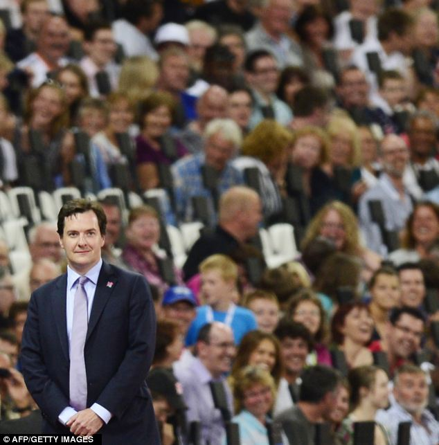 Britain's Chancellor George Osborne is booed by spectators as he prepares to take part in a medal ceremony at the Paralympic Games