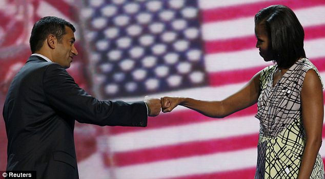 Friendly fist-bump: Kal Penn greets First Lady Michelle Obama on the stage of the Democratic National Convention on Monday as she went through a practice of her speech that she will give Tuesday night