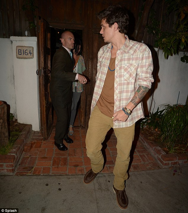 Looking out for her: Mayer kept a watchful eye on Perry as they exited the restaurant