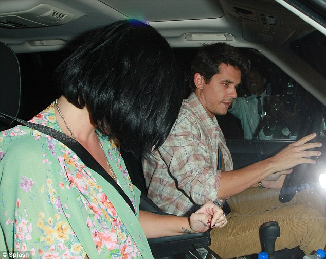 Someone's camera shy: Katy Perry tries to hide her face as she leaves a Los Angeles restaurant with John Mayer