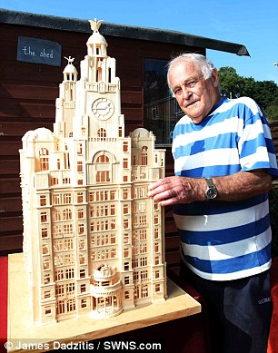 Brian Wherry from Exeter, Devon with his completed model of the Royal Liver Building which took 52,000 matches to construct
