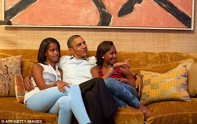 This official White House photographs shows US President Barack Obama and his daughters, Malia (left) and Sasha watch Michelle Obama on television in the Treaty Room of the White House on Tuesday night