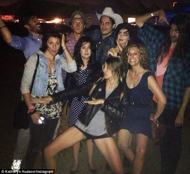 Making a point: The picture of Katy and John partying at a music festival was posted by a Katheryn Hudson, Katy Perry's real name