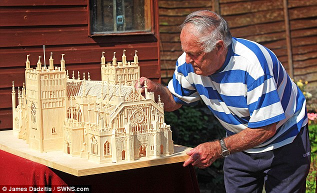 Close study: Mr Wherry's model of Exeter Cathedral was made in tribute to his hometown in Devon, where he lives with his wife Tina, 70