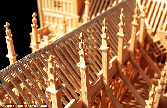 Up close and personal: The Exeter Cathedral model is accompanied in his workshop with versions of London's Tower Bridge and Notre Dame Cathedral in Paris