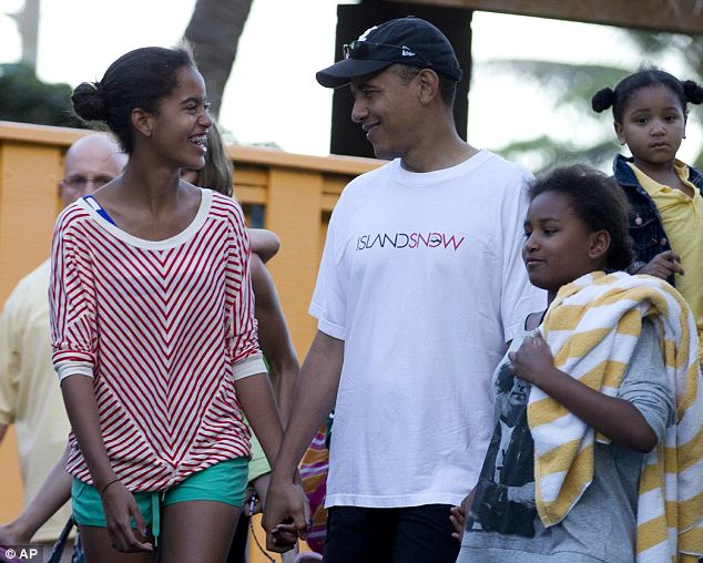 Vacation time: This past Christmas, in 2011, the first family traveled to their father's home state of Hawaii