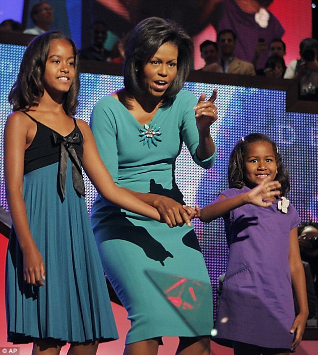 Last night four years ago: The two girls joined their mother on stage at the convention in Denver after her speech in 2008, but they were unable to do the same this year because it was the first day of school